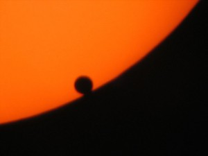 Image of silhuoette of Venus against the disk of the sun.
